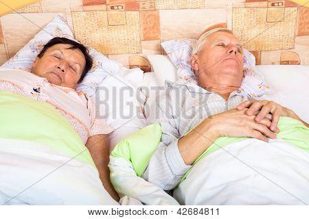 Senior Man And Woman Sleeping