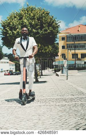A Vertical Shot Of A Dapper Adult Bearded Bald Black Senior In Eyeglasses And A White Fancy Summer C