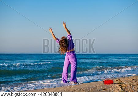 Girl Exercise With Music At Sea Beach