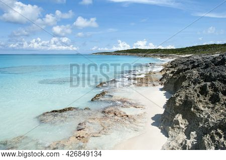 The Scenic View Of Half Moon Cay Rocky Beach And Crystal Clear Caribbean Sea Waters (bahamas).