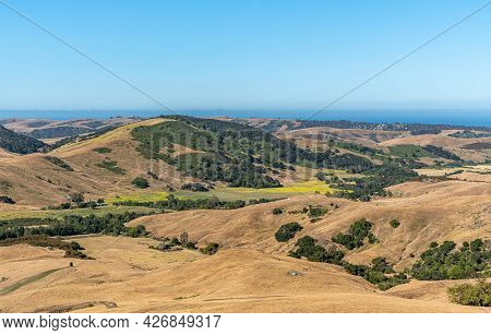 Cambria, Ca, Usa - June 9, 2021: View On Blue Ocean From Back Country Hills Used For Ranching Under
