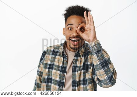 Close Up Portrait Of Happy African American Man, Smiling Cheerful, Looking Through Okay Ok Sign With