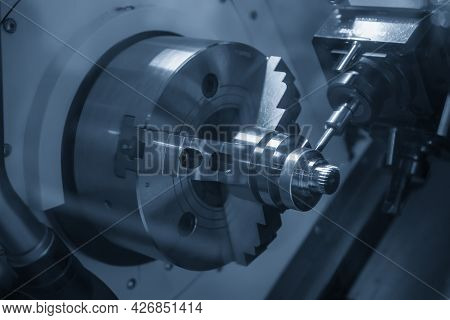 The Turn-mill Machine Cutting The Crank Shaft Part. The Hi-technology Automotive Part Manufacturing