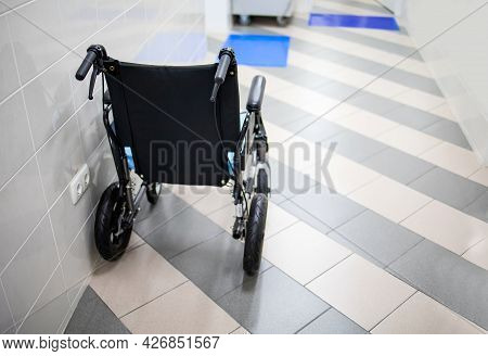 Wheelchair Is Waiting For Patient In Clinic Hallway
