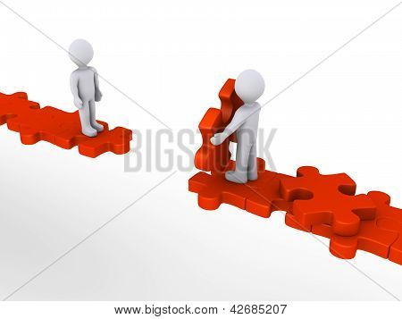 Person Offering Help To Another On Puzzle Path