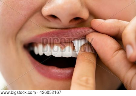 Woman Chewing Wet Moist Nicotine Tobacco Snus Product