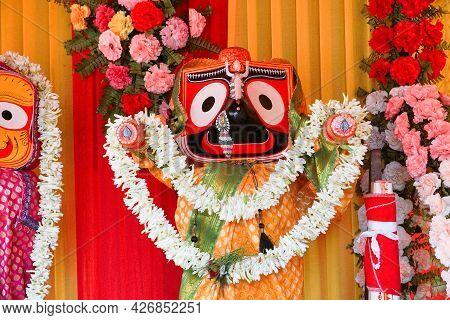 Idol Of Hindu God Jagannath. Lord Jagannath Is Being Worshipped With Garlands For Rath Jatra Festiva