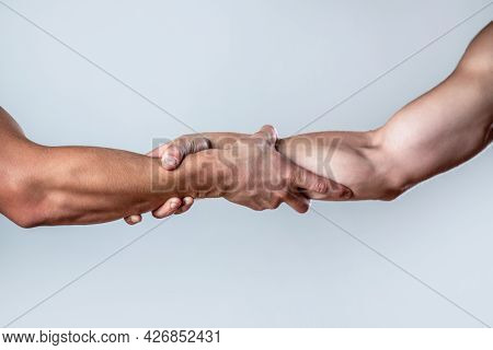 Close Up Help Hand. Two Hands, Helping Arm Of A Friend, Teamwork. Helping Hand Concept And Internati