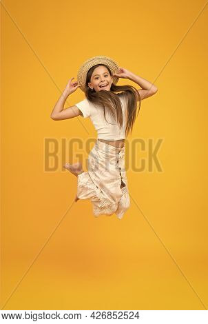 Super Active Child Jump In Straw Hat. Barefoot Kid Feel Freedom. Full Of Happiness. Summer Kid Fashi