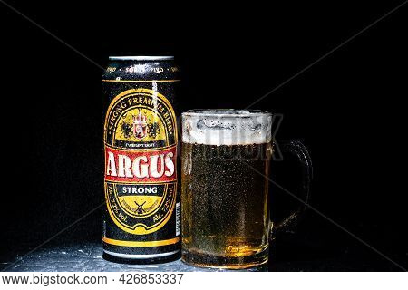 Can Of Argus Beer And Beer Glass On Dark Background. Illustrative Editorial Photo Shot In Bucharest,