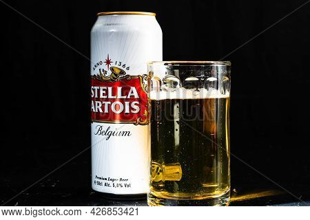 Can Of Stella Artois Beer And Beer Glass On Dark Background. Illustrative Editorial Photo Shot In Bu