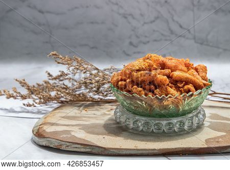 Crispy Chicken Skin Chili Paste In Glass Bowl On Marble Table. Fried Chili And Fried Crispy Chicken