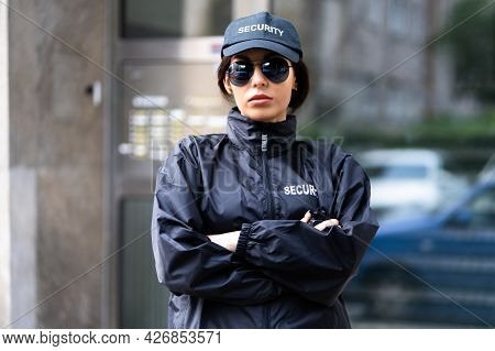 Security Guard Officer In Uniform. Guard Service Woman Standing