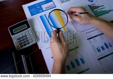 Close-up Of Auditor Hand Looking At Accounting Records, Auditing Tax,  Balance Sheet, Analyzing Bill