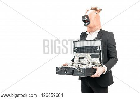 Money Is Wealth. Businessman In Horse Head Mask Hold Suitcase With Dollars. Investment For Money