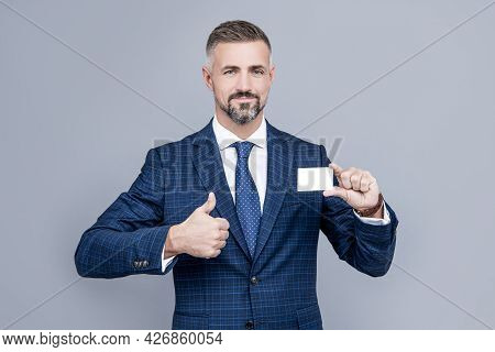 This Is Success. Businessman Demonstrating Credit Card. Empty Plastic Business Name Card.