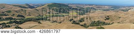 Cambria, Ca, Usa - June 8, 2021: Panorama Landscape On Back Country With Farm And Ranch Land And Pat