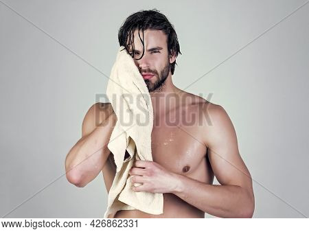 Man In Bathroom With Muscular Body On Grey Background. Morning Washing, Wake Up, Everyday Life. Refr