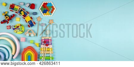 Baby Kids Toys On Light Blue Background. Colorful Educational Wooden And Musical Toys. Top View, Fla