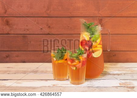 Cold Summer Lemonade With Lemon, Strawberry And Lime In Pitcher And  Glasses On Aged Wooden Table. S