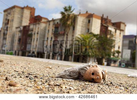 Abandoned Broken Doll Head