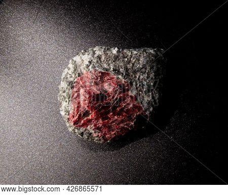 Garnet Stone Crystal Inside Granite And Quartzite Rock On Black Background. Found In Kem, Karelia, R