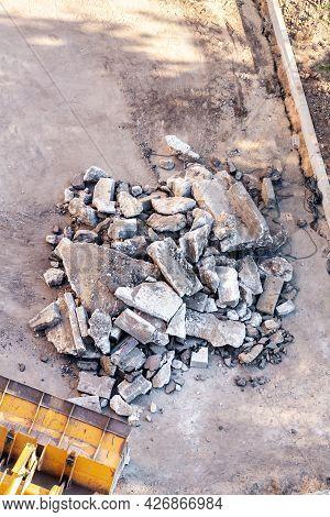 Concrete And Brick Rubble Debris With Excavator Bucket Construction Site Top View.
