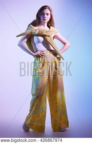 Romantic summer style. Beautiful fashion model girl poses in stylish summer clothes. Studio full length portrait. Fashion shot.