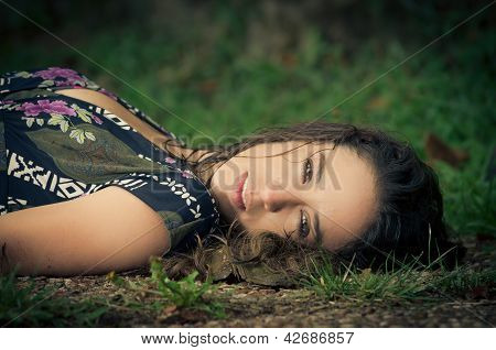 calm woman laying in the park