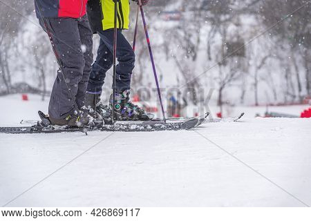 Two Abstract Skiers On Ski Slope, Snow Day, Selective Focus. Winter Sport And Recreation Concept