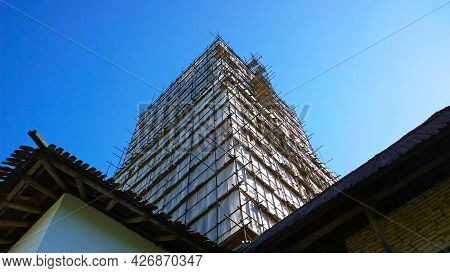 Building Facade Renovation, Scaffolding. Restoration Of Ancient High House. Renovation And Reconstru