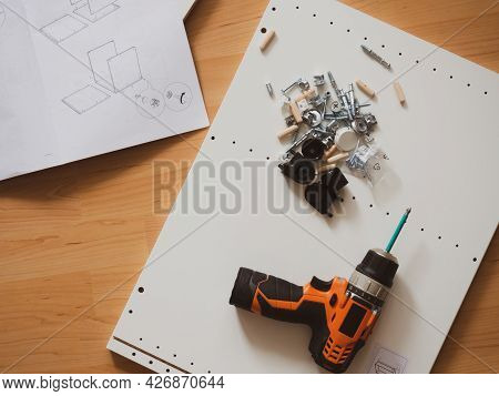 Furniture Assembly Concept, Fittings, Screwdriver And Assembly Instructions With Place For Your Text