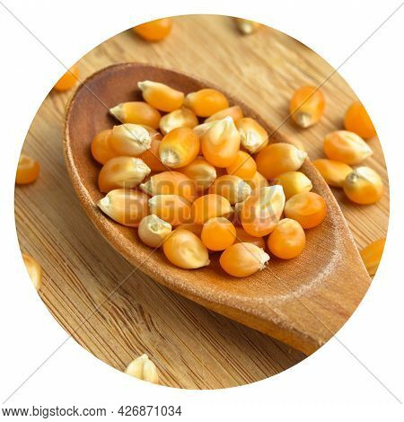 Yellow Maize Corn Kernels Ready For Making Popcorn, On Cutting Board Bamboo And In Wooden Spoon