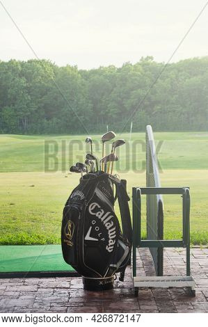 Ukraine, Kharkiv, June 2021. Golf Clubs In A Bag On The Background Of A Green Lawn In A Golf Club.