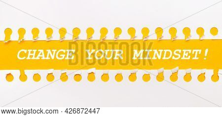Torn Paper Strip On Yellow Background With Text Change Your Mindset