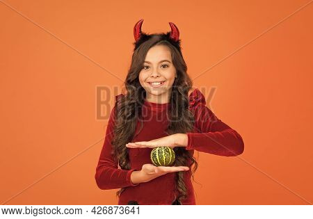 Happy Devil Child With Pumpkin Vegetable Wear Horns Costume Of Imp On Halloween Party, Happy Hallowe
