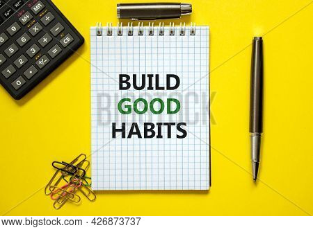 Build Good Habits Symbol. Words 'build Good Habits' On White Note. Yellow Background, Paper Clips, M