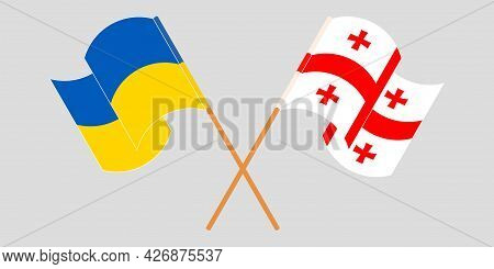Crossed And Waving Flags Of Georgia And The Ukraine