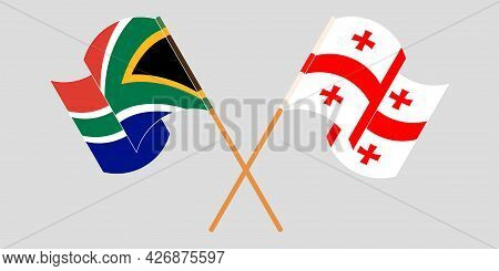 Crossed And Waving Flags Of Georgia And Republic Of South Africa