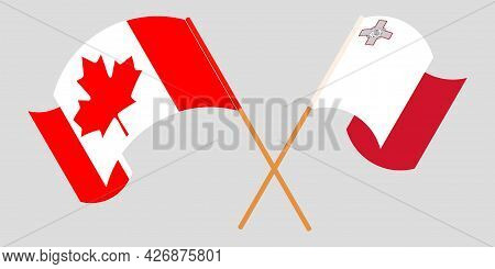 Crossed And Waving Flags Of Malta And Canada