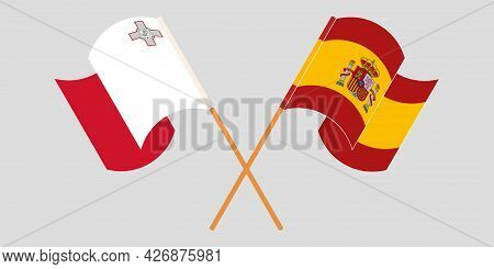 Crossed And Waving Flags Of Malta And Spain