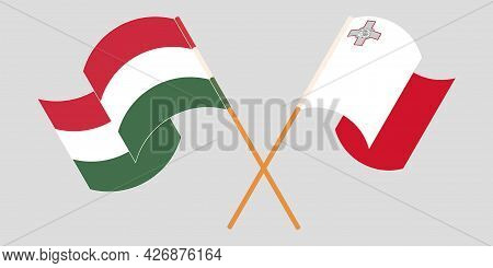 Crossed And Waving Flags Of Malta And Hungary