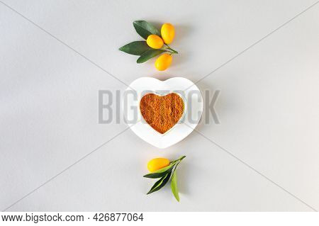 Turmeric In A Heart Shaped Plate. Healthy Food Concept., Top View.