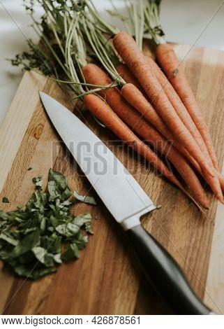 Fresh organic carrots on a cutting board