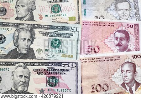 Close-up On A Stack Of Us Dollars And Bosnia And Herzegovina Convertible Mark.