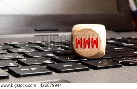 Www Word On Wooden Block Sign On A Keyboard, White Background.