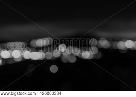 Darkness And Light, Abstract City Lights Circles Of Lights Against Dark Night Background.