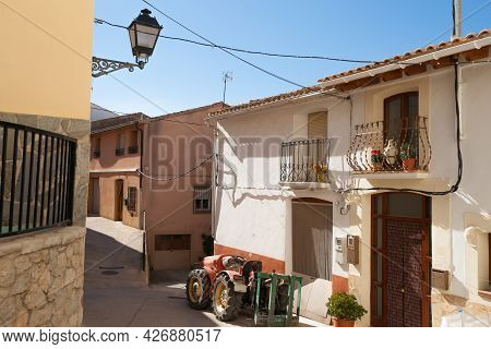 Tractor Parked In Very Tidy Street Between Two Story Homes In Small Mountain Town Tarbena, Spain