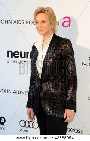 LOS ANGELES - FEB 24:  Jane Lynch arrives at the Elton John Aids Foundation 21st Academy Awards Viewing Party at the West Hollywood Park on February 24, 2013 in West Hollywood, CA