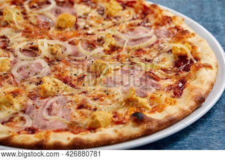 pizza on the wooden background